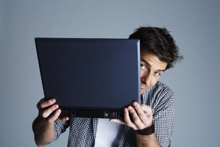 Man-Holding-Laptop-449x300